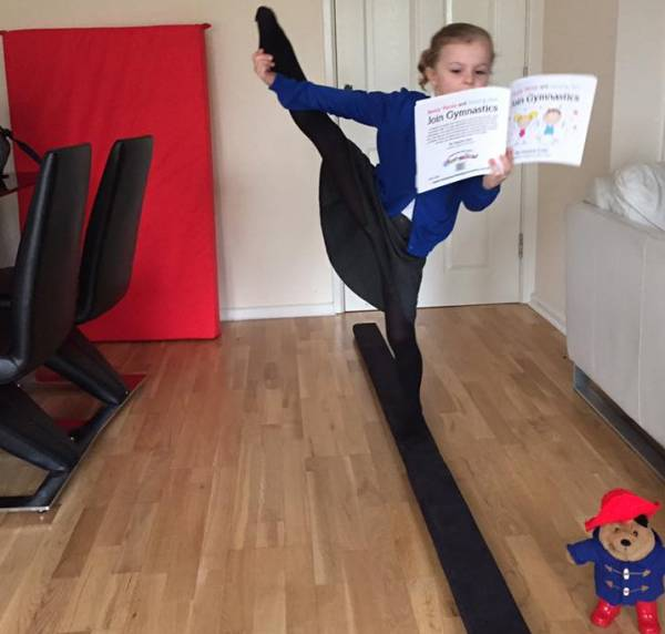 Picture of gymnast using gymnastics story book