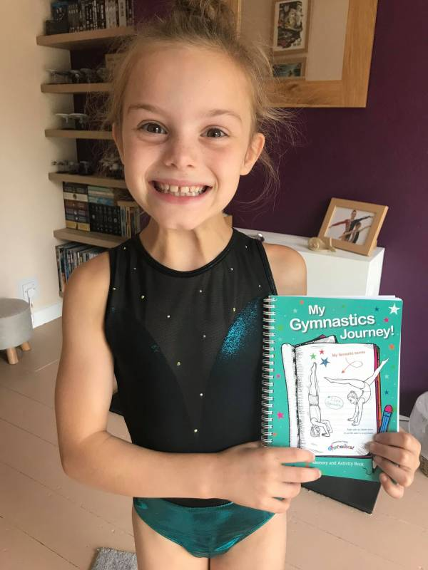Smiley Gymnast with her Gymnastics Journal